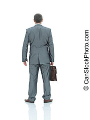 Rear view of a businessman in gray business suit with brown...