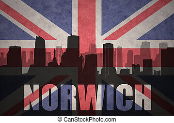 abstract silhouette of the city with text Norwich at the vintage british flag