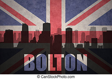 abstract silhouette of the city with text Bolton at the vintage british flag