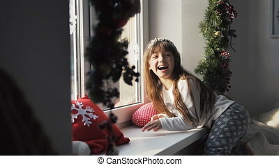 Kid Girl Having Fun near Windowsill - Kid girl having fun...