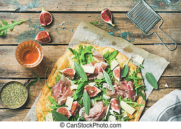 Fig, prosciutto, arugula, sage flatbread pizza and rose wine...