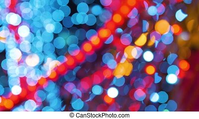 garlands Fires burn and flicker shimmer in soft focus bokeh Christmas or New Year background.