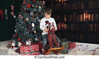 Boy Having Fun with Wooden Horse Toy