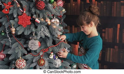 Happy Kid Dressing up the Christmas Tree - Happy kid girl...
