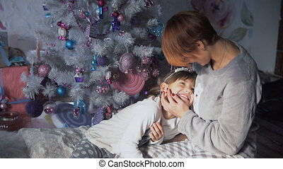 Mother with her Daughter in Christmas Time - Happy mother...