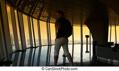 Tourist walking on observation deck on tower in Ho Chi Minh...