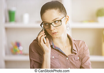 Attractive businesslady on phone - Close up portrait of...