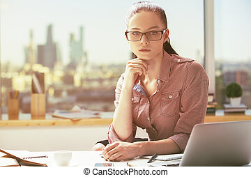 Portrait of girl at workplace - Portrait of thoughtful...