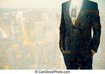 Businessperson on city background - Businessperson in suit...