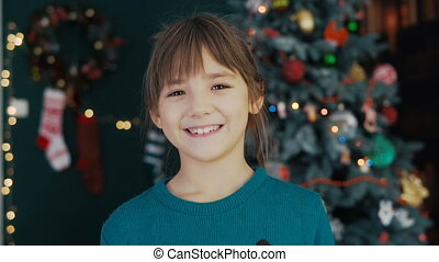 Portrait of Kid Girl Before Christmas Tree