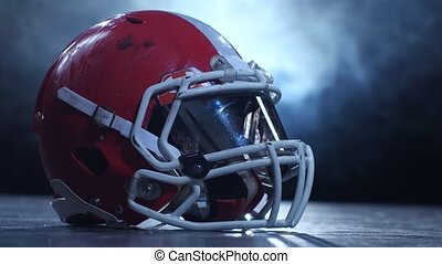 Helmet american football players in the smoke background. Clous up