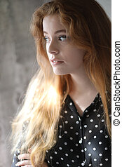 Red Haired Woman in Black Polka Dot Top
