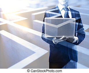 Business challenge concept - Young man with laptop on...