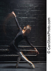Experienced dancer performing on the dark background -...