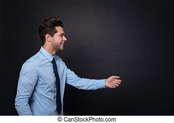 Pleasant delighted man expressing positivity. - Give it to...
