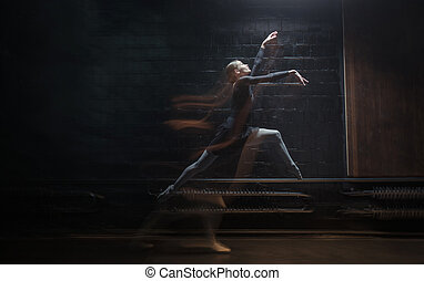 Young gymnast jumping on the dark background - Great...