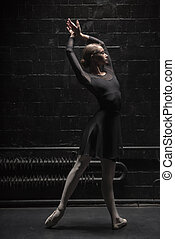 Serious young dancer training near the wall - Every day...