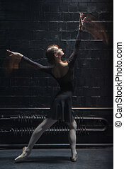 Artistic dancer posing on the dark background - The art of...