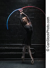 Involved ballet dancer acting with a colorful gymnastic...
