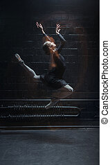 Inspired dancer jumping on the dark background - Full of...