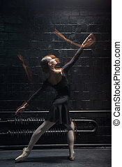 Skilled dancer performing on the dark background - The art...