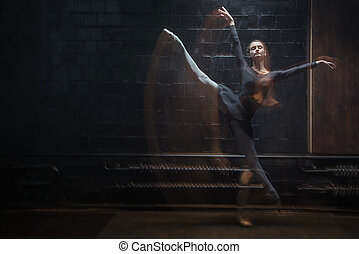 Young dancer jumping in front of the black wall - Dancer in...