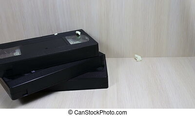 stack of VHS video tape cassette and popron - TV remote....