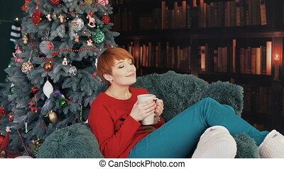 Beautiful Redhead Woman in Armchair - Beautiful redhead...