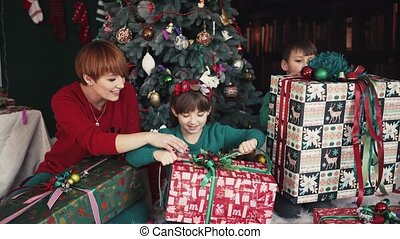 Christmas Morning Family - Mother with her happy kids have...