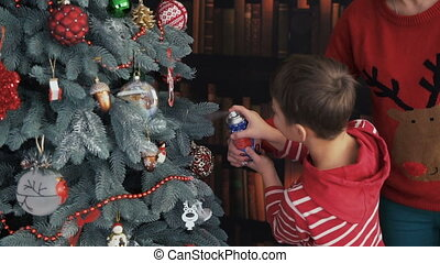 Boy Making Artificial Snow on Christmas Tree