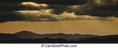 panoramic winter sunset high up on the silhouette mountains...