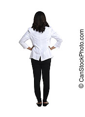 Back view of a female doctor looking at white