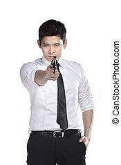 Portrait of srcret agent holding a gun