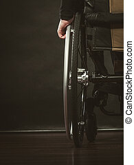 Disabled person sitting on wheelchair. - Disease disability...