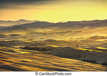 Volterra panorama, rolling hills and green fields on sunset. Rural landscape. Tuscany, Italy