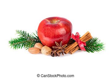 Red apple with christmas spices on white. Apple rustic still...