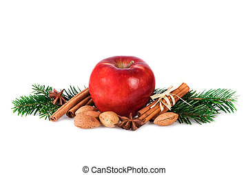 Red apple with christmas spices decoration on white