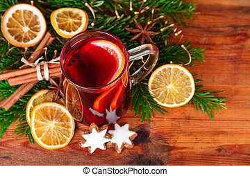 Christmas mulled wine with winter spices on dark wood. Top...