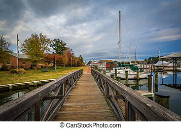 Bridge and boats docked in the harbor, in St. Michaels,...