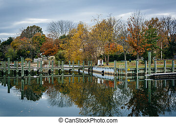 Docks and autumn color at Oak Creek Landing, in Newcomb,...