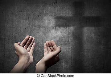 Human hand praying to god. Religious concept image