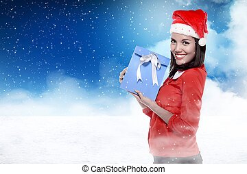 Asian woman wearing santa hat holding gift with colorful...
