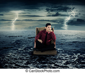 Business man sitting on armchair in the ocean