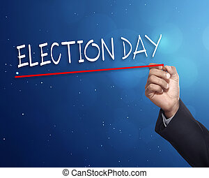 Man hand writing a 'ELECTION DAY' with gold marker on visual...