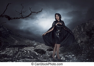 Asian woman wearing black costume, she standing on the rock...