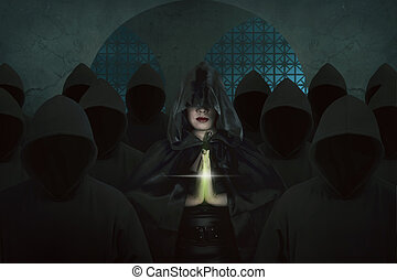 Asian witch woman inside old castle in the dark room praying...
