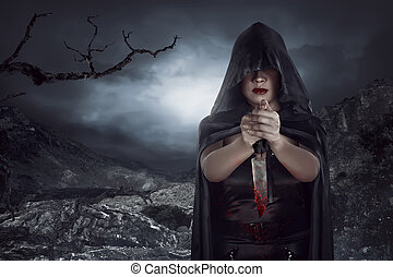 Asian woman holding knife cofered blood on the rock mountain