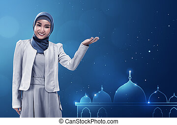 Young asian muslim woman give smile on mosque background...