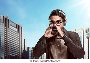 Asian man wearing headphone and shouting with mouth