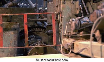 Brick production. View of old working equipment, close-up